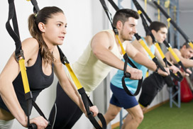 Group of people working out on TRX equipment