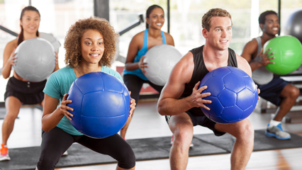 Group exercising with medicine balls